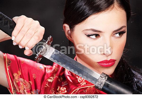 woman and katana/sword - csp9392872