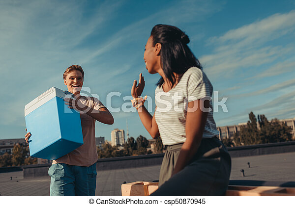 woman and man with portable fridge - csp50870945
