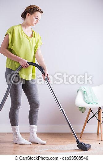 Woman and vacuum - csp33508546
