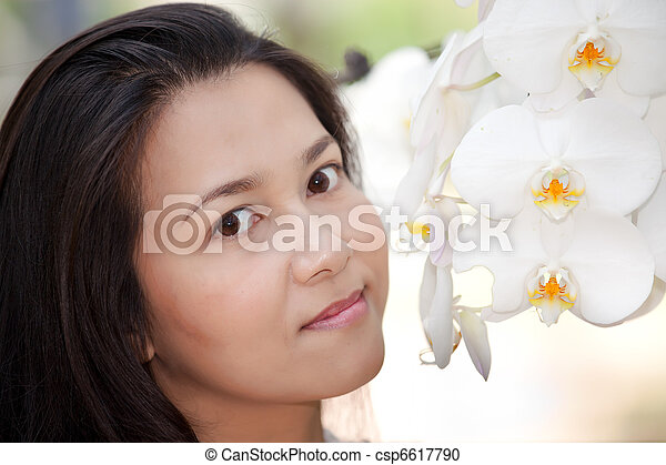woman and white orchid - csp6617790