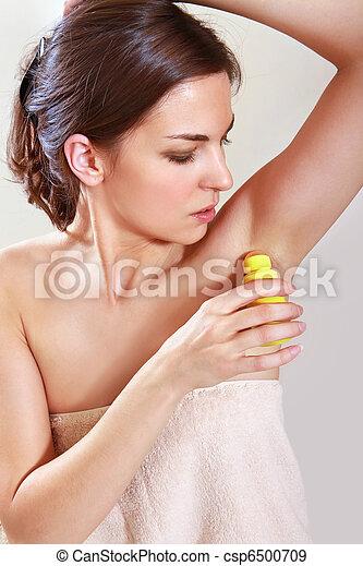 woman applying deodorant - csp6500709