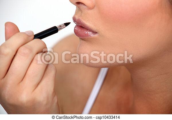 Woman applying make-up - csp10433414