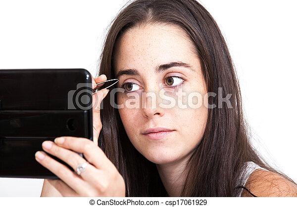 woman applying make-up  - csp17061929