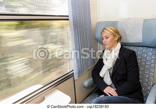 Woman asleep in train compartment tired resting - csp18238193