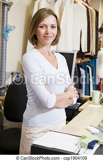 Woman at clothing store smiling - csp1904109