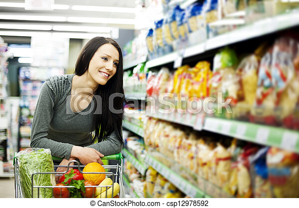 Woman at groceries store - csp12978592