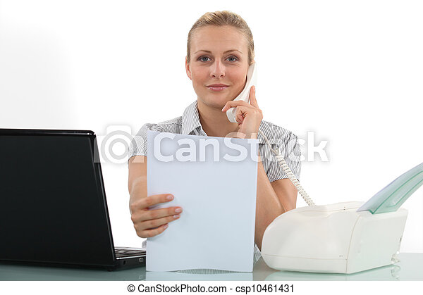 Woman at her desk using fax - csp10461431