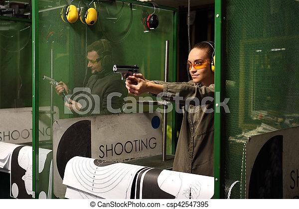 woman at the shooting range. - csp42547395
