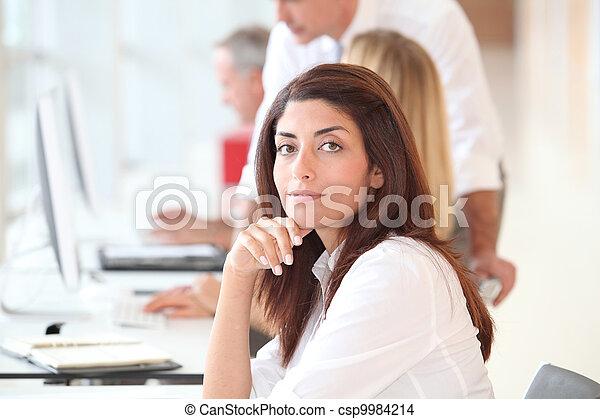 Woman attending business training - csp9984214