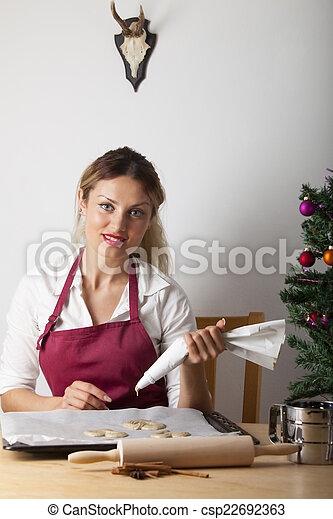 woman baking with a christmas tree - csp22692363