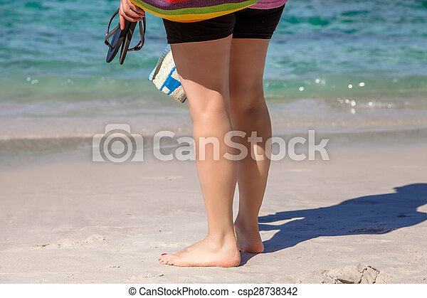 Woman barefoot on sand - csp28738342