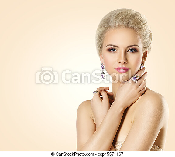 Woman Beauty Face and Jewelry, Beautiful Fashion Model Makeup, Young Girl Make Up and Jewellery, over Beige Background - csp45571167