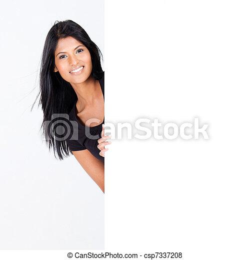 woman behind blank white board - csp7337208