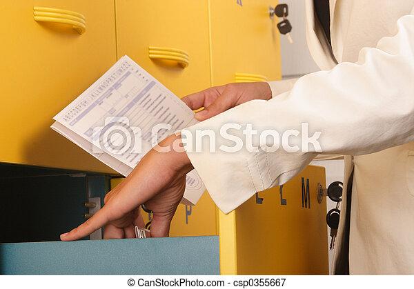 woman browsing files - csp0355667