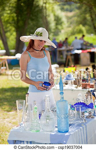 Woman buying antique collectibles, Provence, France. - csp19037004