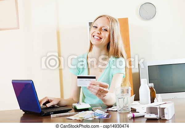 woman buying drugs online with laptop and card - csp14930474
