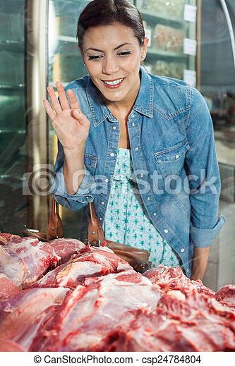 Woman Buying Meat In Butchery - csp24784804