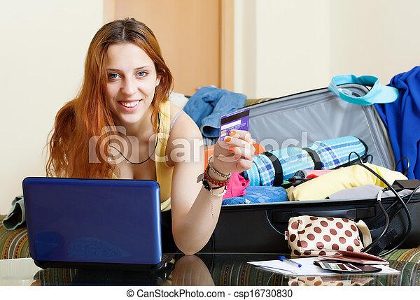 woman buying tickets online in internet - csp16730830