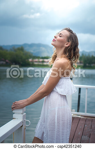 Woman by the lake - csp42351240