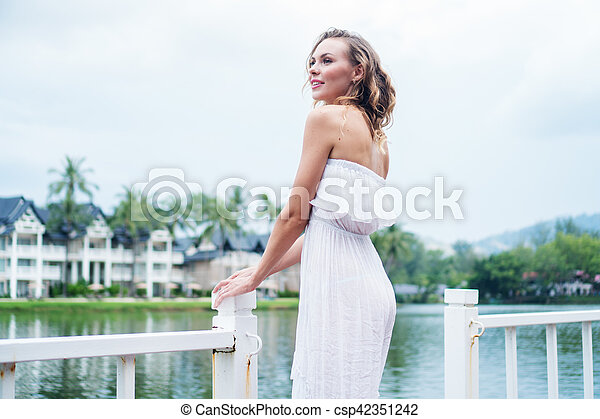 Woman by the lake - csp42351242