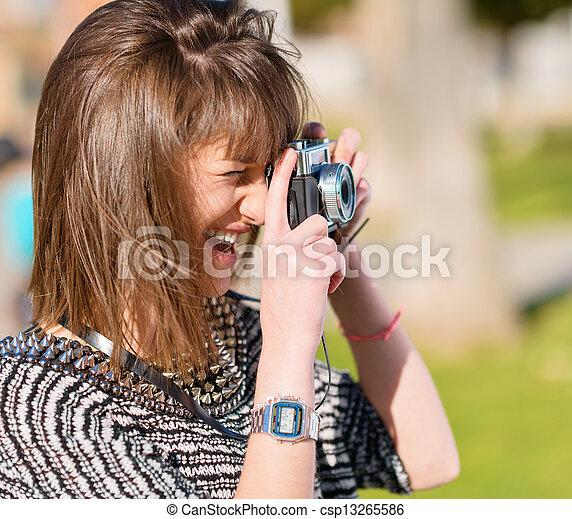 Woman Capturing Photo With Camera - csp13265586
