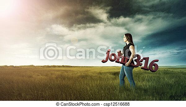 Woman carrying Bible verse. - csp12516688