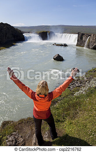 Woman Celebrating At Godafoss Waterfall, Iceland - csp2216762