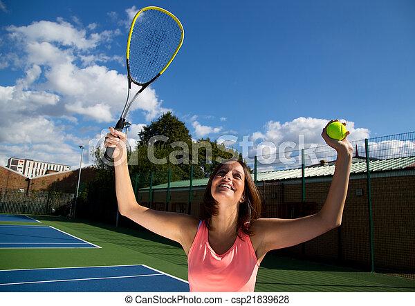 woman celebrating winning tennis match - csp21839628