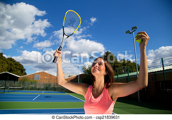 woman celebrating winning tennis match. - csp21839631