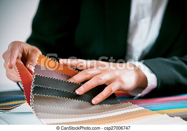 Woman checking fabric color swatches - csp27006747