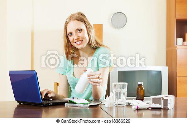 woman choosing medication in online pharmacy - csp18386329