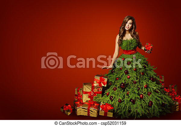 woman christmas tree dress with present gift xmas fashion gown over red new year background