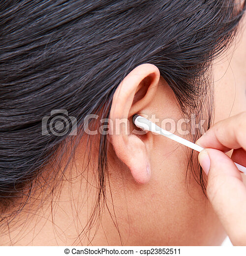 Woman cleaning ear using cotton stick - csp23852511