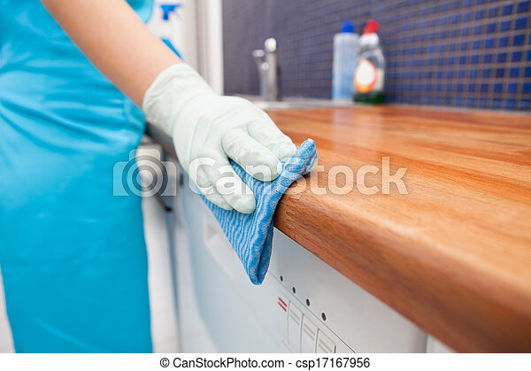 Woman Cleaning Kitchen Countertop - csp17167956