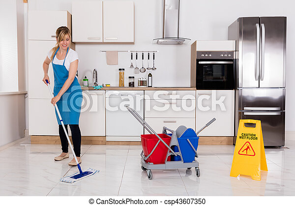 Woman cleaning kitchen floor with mop. Cleaning service janitor ...