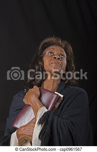 Woman Clutching Bible Looking Up - csp0961567