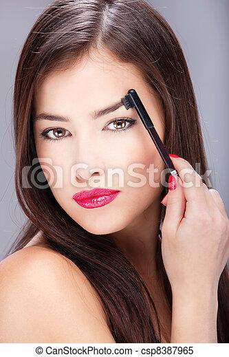 woman combing eyebrow - csp8387965