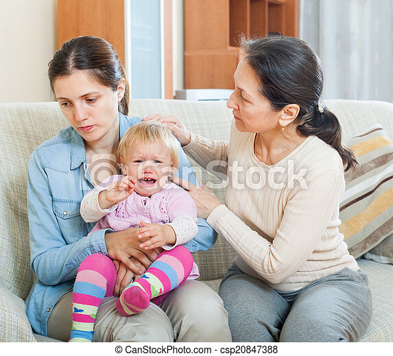 woman comforting  adult daughter with toddler  - csp20847388