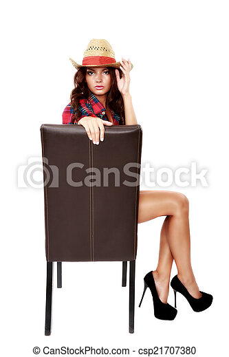 woman cowgirl sitting on a chair isolated on white - csp21707380