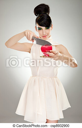 woman cutting heart with knife - csp8932900