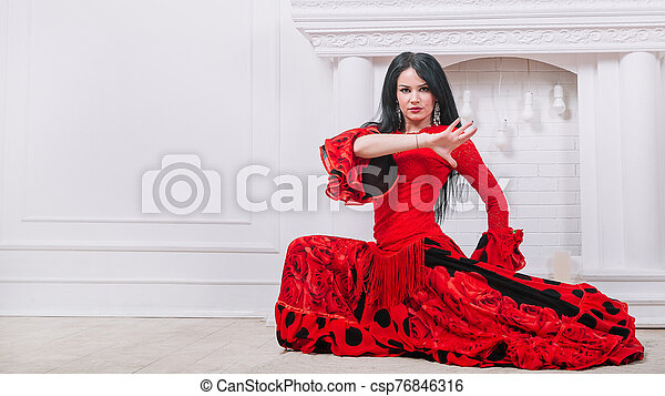 woman dancer in red dress performing Gypsy dance - csp76846316