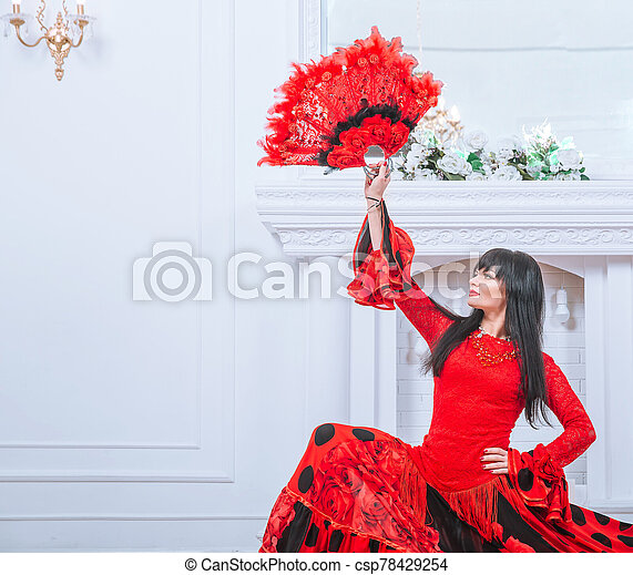 woman dancer in red dress performing Gypsy dance - csp78429254