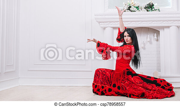 woman dancer in red dress performing Gypsy dance - csp78958557