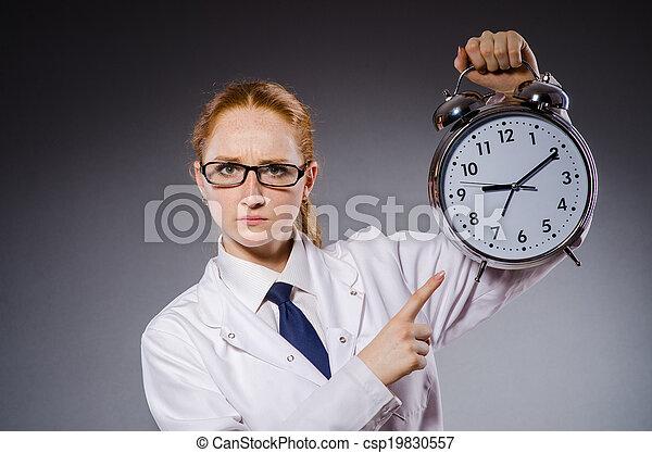 Woman doctor missing her deadlines - csp19830557