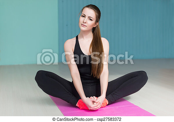 woman doind exercise butterfly for flexible legs concept