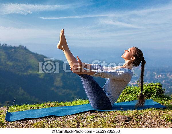 woman doing ashtanga vinyasa yoga asana navasana  boat