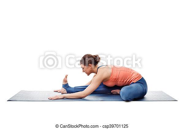 woman doing ashtanga vinyasa yoga asana janu sirsasana