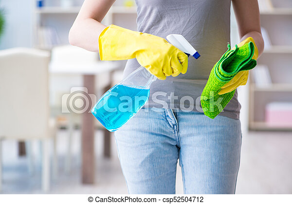 Woman doing cleaning at home - csp52504712