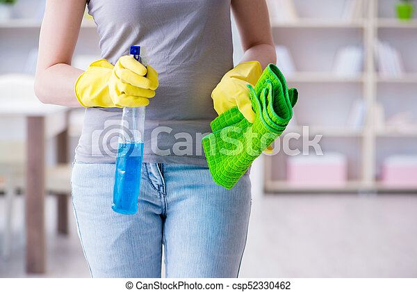 Woman doing cleaning at home - csp52330462