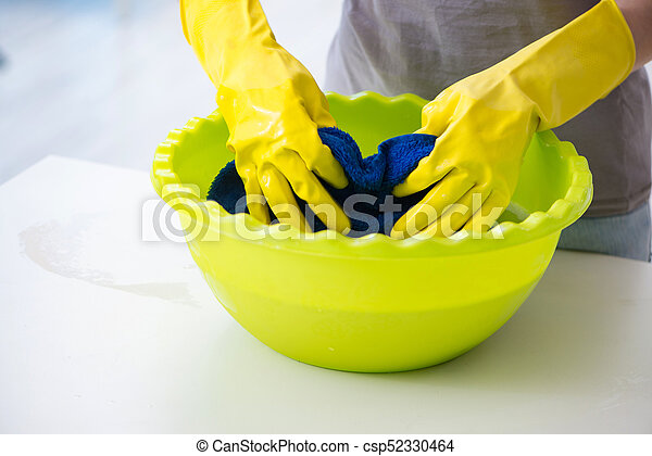 Woman doing cleaning at home - csp52330464